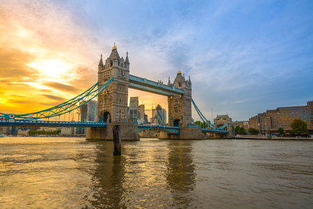 Famous Tower Bridge in the evening with sunset sky and reflex on water, London, England
