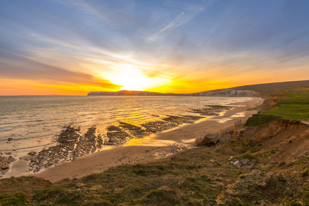 Sunset landscape and cliffs on Tennyson Down on the Isle of Wight, off the south coast of the United Kingdom.