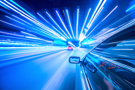 View from Side of Car moving in a night city, Blured road with lights with car on high speed.