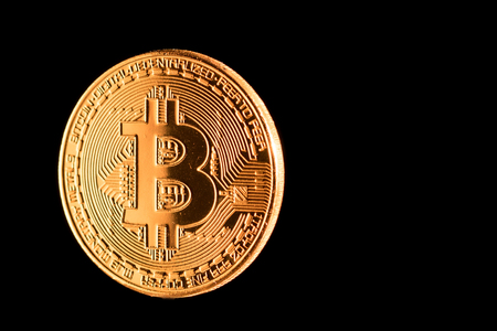 golden bitcoin criptocurrency isolated on black background
