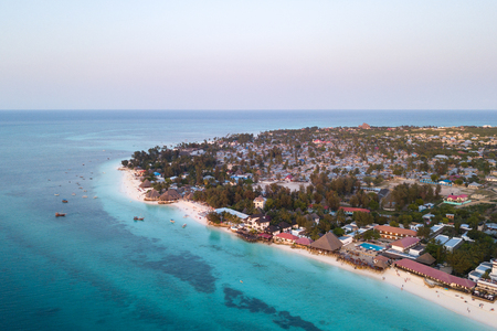 landscape: Beautiful Zanzibar Nungwi beach at sunset time aerial view