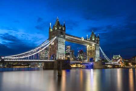 Famous Tower Bridge in the evening with blue sky and reflex on water, London, England Stock Photo
