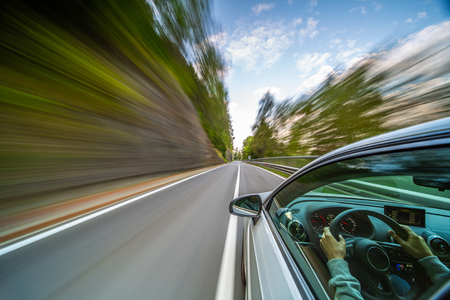 Car in motion blur driving in the Italian mountains Banco de Imagens - 116066042