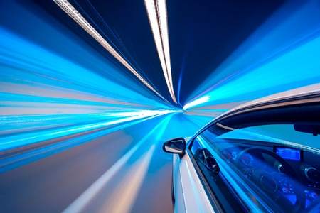 Abstract Blue color tunnel car driving motion blur
