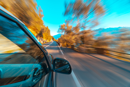 Car in motion blur driving in the Italian mountains Banco de Imagens - 116066345