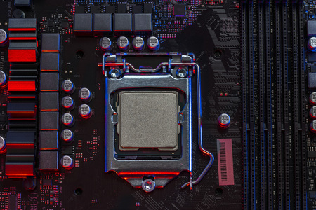 desktop processor 9th gen on background motherboard closeup top view, Red and Blue color light