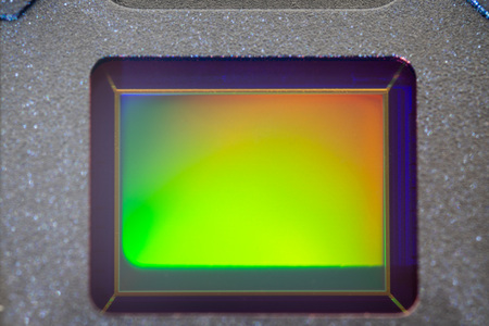 Small Digital smartphone camera CMOS Sensor macro shot with rainbow reflection