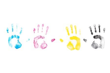 CMYK Color hand prints on white background. Cyan, Magenta, Yellow, Black laser printer toner.