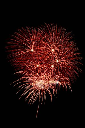 Red Fireworks of various colors isolated on black background