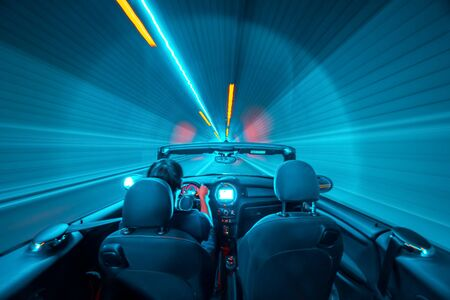 Abstract speed concept. Driver in a cabrio vehile ina a tunnel. motion blur.