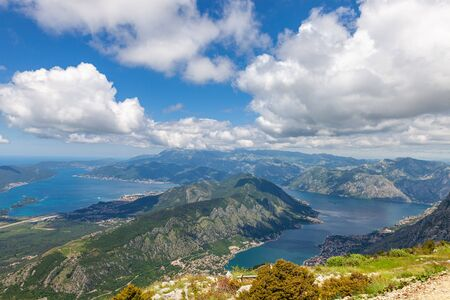 Bay of Kotor with birds-eye view. The town of Kotor, Muo, Prcanj, Tivat. View of the mountains, sea, clouds Imagens