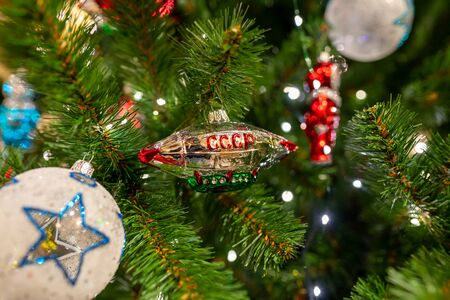 Closeup of christmas tree with Soviet Union style balls and light. Christmas background. Imagens