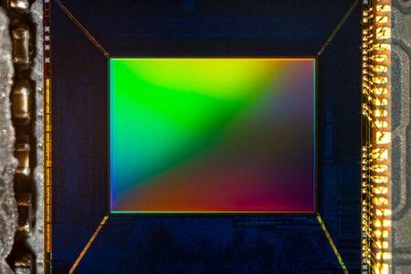 Small Digital smartphone camera CMOS Sensor macro shot with rainbow reflection Stock fotó