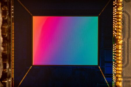 Macro shot small Digital smartphone camera CMOS Sensor with rainbow reflection