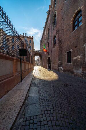 ROVERETO, ITALY - FEB 20, 2020: Medieval city street Feb 20, 2020 in Rovereto, Italy. It is a landmark city near Dolomites alps. Editorial