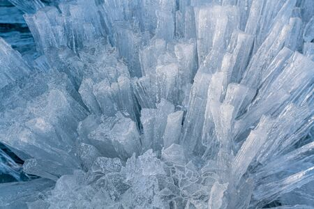 Ice sticks from water of Baikal lake for background