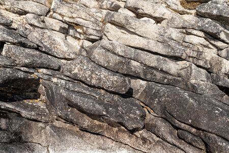 Structure of surface of the stone, used as background. Stone texture. Natural rocks