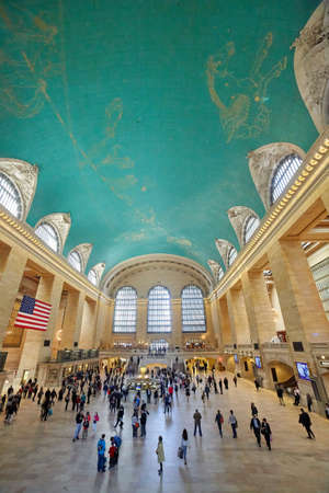NEW YORK, NY, April 22, 2015: commuters and tourists in the grand central station in April 22, 2015 in New York. It is the largest train station in the world by number of platforms: 44, with 67 tracks