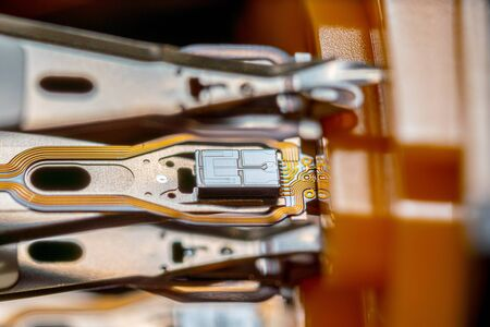 Extreme close up of hard disk drive HDD head.