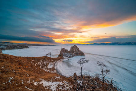 Landscape view of the mountain Shamanka cape in sunset sky, Burkhan island Olkhon at Baikal lake, Russia