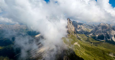Amazing aerial top view on Seceda Mount peak and valley from drone. Trentino Alto Adige, Dolomites Alps, South Tyrol, Italy, Europe near Ortisei.