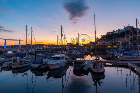 View of the harbor of Torquay at colorful sunset., Devon, England Stock Photo