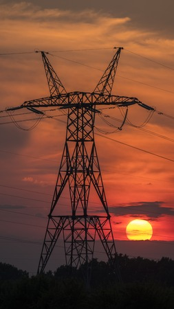 Power line pole on the background of sunset and beautiful sky Stockfoto