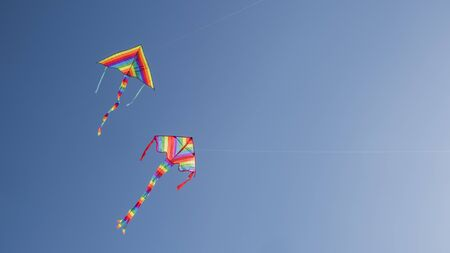 Two childrens toys - kites fly in the sky