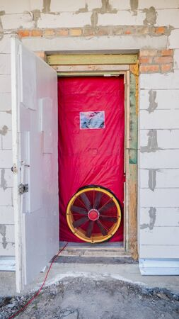 Blower door test: Testing the house for airtightness, on the front door installed a powerful fan.