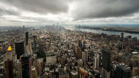 View of the Manhattan business district in New York, USA. Dramatic sky over the city