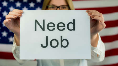 Woman holding a poster Need Job. Employment in the USA