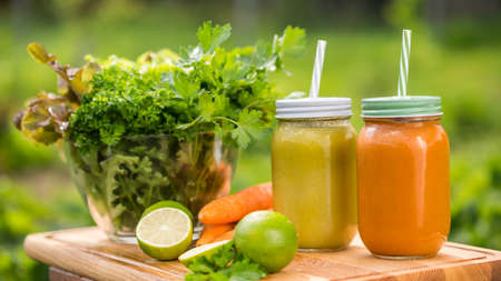 Useful vitamin drinks: A set of useful smoothies made of fresh fruit and greenery.