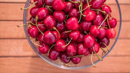 A full bowl of cherries is on the table