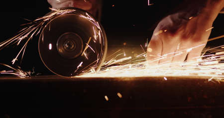 Metal treatment by grinding circle, welder grinds welds