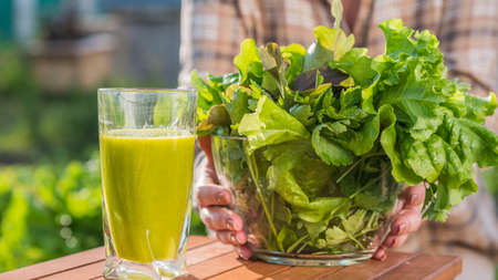 Farmer offers vitamin drink made from green salad leaves