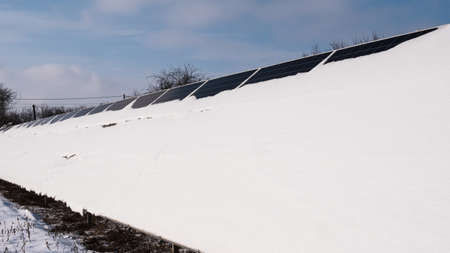 Snow on solar power plant panels