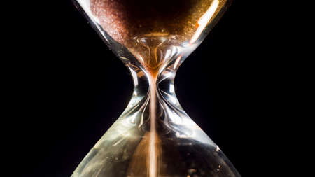 Hourglass close-up on a black background