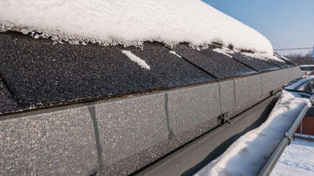 Snow on the roof and in the gutter. Engineering systems for drainage of melt water