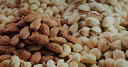 Bunches of assorted healthy nuts - almonds, pistachios, cashews and hazelnuts. Source of vitamins