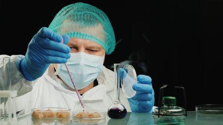 Man tests chicken meat samples, checks for chicken flu virus 写真素材