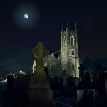 Church and celtic crosses with full moon Castleknock Stock Photo