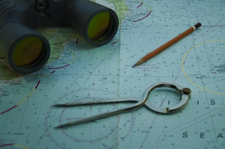 compas: Essential tools for navigation at sea  parallel ruler, plotter compas divider binokulars, chart  Stock Photo