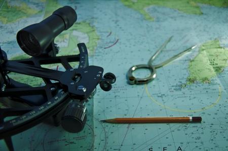 plotter: Essential tools for navigation at sea  parallel ruler, plotter compas divider binokulars, chart  Stock Photo
