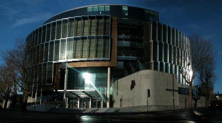 Four Courts building in Dublin, Ireland with bronze sculpture