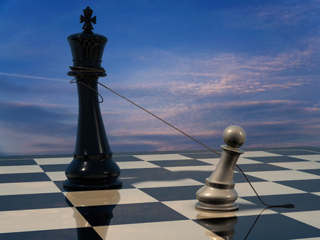 defeated: End of the battle: Chess King is being defeated by pawn. Stock Photo