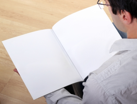 Man holds empty brochure