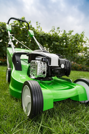 lawn mower: Outdoor shot of green lawnmower.