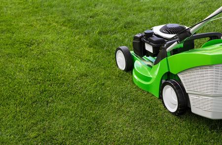 gardening    equipment: Outdoor shot of green lawnmower Stock Photo