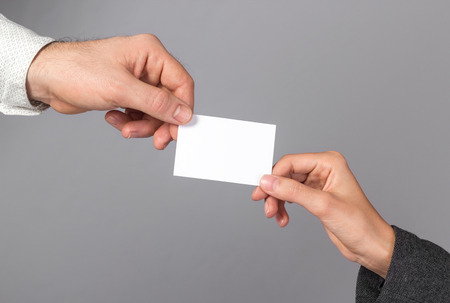 namecard: Man and woman holding blank business card