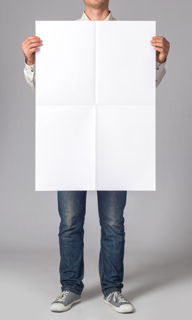 Man holding a blank poster 스톡 콘텐츠